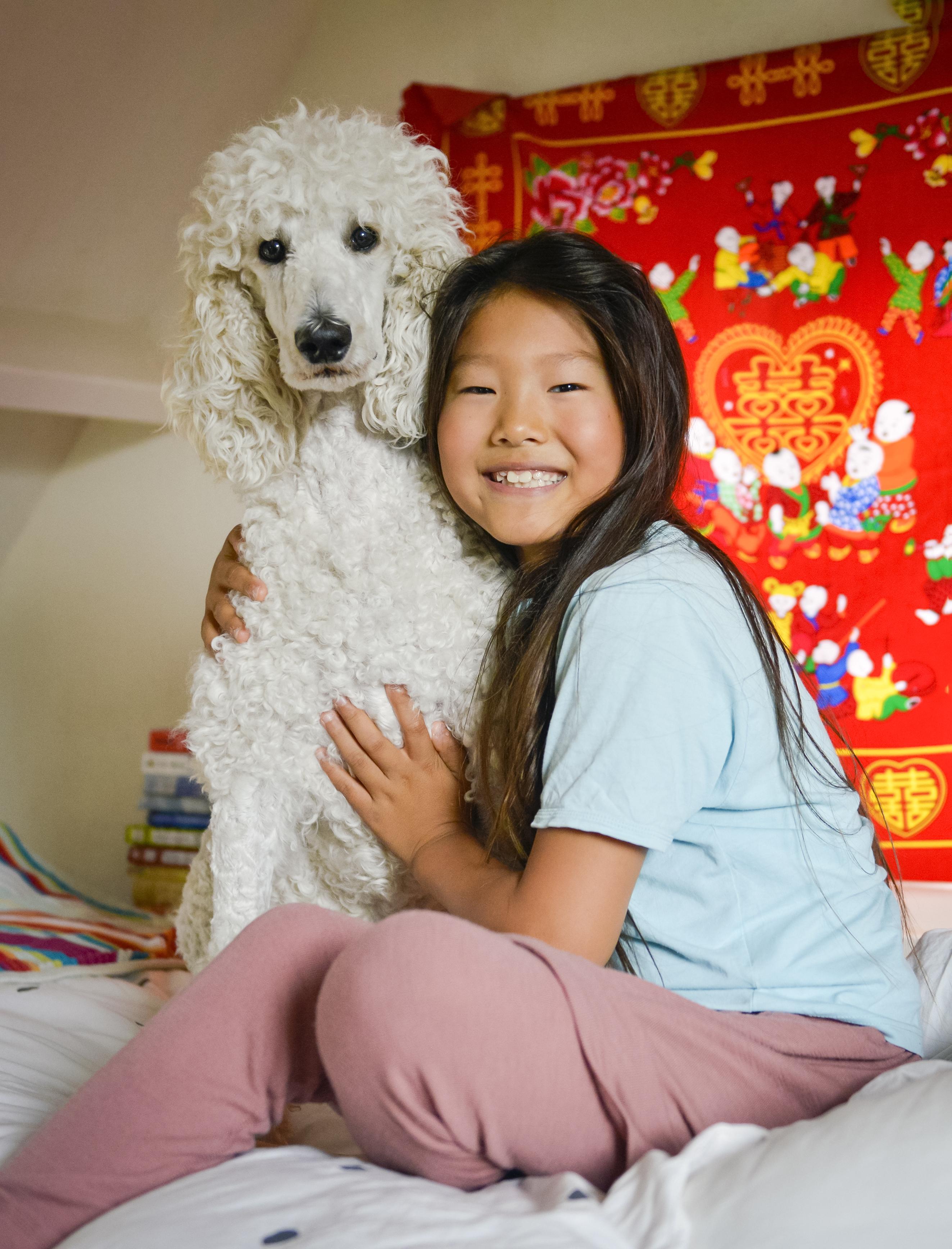 Wen Long (9) ziet eruit als een meisje, maar zo simpel is het niet. 'Ik ben geboren als intersekse. Dat is dat je jongen én meisje bent'